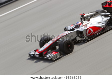 SEPANG, MALAYSIA - MARCH 23: British Jenson Button of Team McLaren drives down the main straight during Friday practice at Petronas Formula 1 Grand Prix March 23, 2012 in Sepang, Malaysia