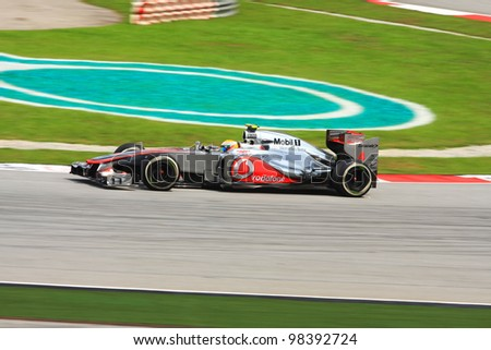SEPANG, MALAYSIA - MARCH 24: British Lewis Hamilton of McLaren-Mercedes takes corner during third practice session at Petronas Formula 1 Grand Prix on March 24, 2012 in Sepang, Malaysia