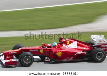 SEPANG, MALAYSIA - MARCH 23: Close up of Spanish Fernando Alonso of Team Scuderia Ferrari exiting turn 15 during Friday practice at Petronas Formula 1 Grand Prix March 23, 2012 in Sepang, Malaysia