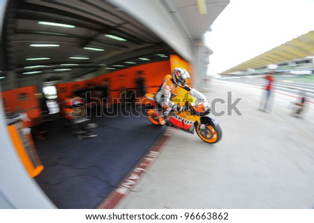 SEPANG,MALAYSIA-MARCH 1: Dani Pedrosa of Repsol Honda Team at 2012 MotoGP Official Winter Test Sepang 2 on Mar. 1, 2012 in Sepang, Malaysia.The 2012 MotoGP season starts on April 8 in Qatar.