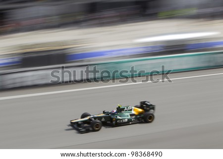 SEPANG, MALAYSIA - MARCH 23: Finnish Russian Vitaly Petrov down the main straight during Friday practice at Petronas Formula 1 Grand Prix March 23, 2012 in Sepang, Malaysia