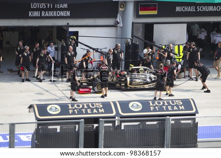 SEPANG, MALAYSIA - MARCH 23: French Romain Grosjean of Team Lotus does a trial pit during Friday practice at Petronas Formula 1 Grand Prix March 23, 2012 in Sepang, Malaysia
