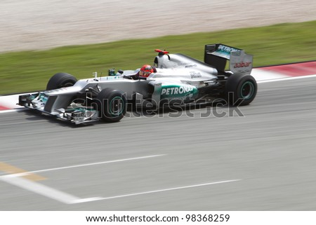 SEPANG, MALAYSIA - MARCH 23: German Michael Schumacher of Team Mercedes AMG exits turn 15 during Friday practice at Petronas Formula 1 Grand Prix March 23, 2012 in Sepang, Malaysia
