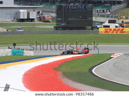 SEPANG, MALAYSIA - MARCH 23: German Sebastian Vettel of Red Bull Racing-Renault in action during Friday practice at Petronas Formula 1 Grand Prix on March 23, 2012 in Sepang, Malaysia