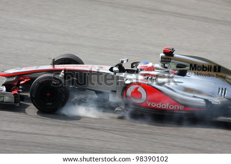SEPANG, MALAYSIA - MARCH 23: Jenson Button of Vodafone McLaren Mercedes brakes hard during Petronas Malaysian Grand Prix practice session at Sepang F1 circuit on March 23, 2012 in Sepang, Malaysia.