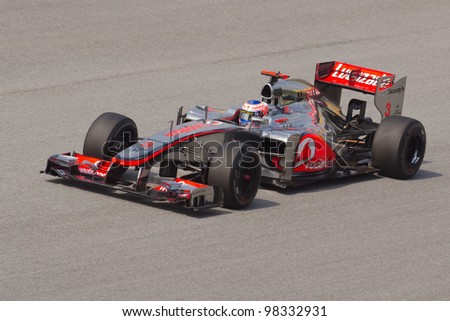 SEPANG, MALAYSIA - MARCH 23: Jenson Button of Vodafone McLaren Mercedes takes to the tracks on practice day of the Petronas Malaysian F1 Grand Prix on March 23, 2012 in Sepang, Malaysia.
