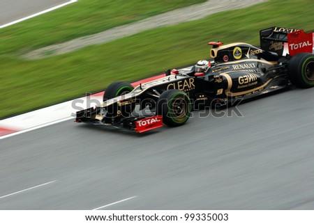 SEPANG, MALAYSIA - MARCH 25: Lotus-Renault F1 Team driver Kimi Raikkonen in action during race day of Petronas F1 Malaysian Grand Prix at Sepang Circuit on March 25, 2012 in Sepang, Malaysia