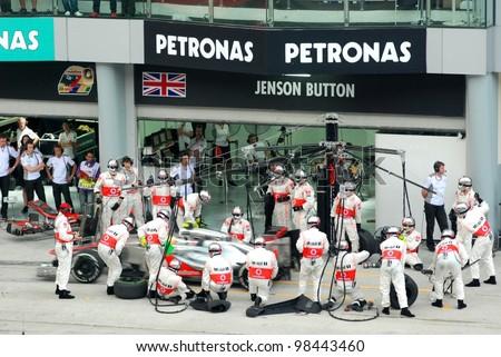 SEPANG, MALAYSIA - MARCH 25: McLaren Mercedes Team crews does pit-stop practice at the 2012 F1 Petronas Malaysian Grand Prix at Sepang International Circuit on March 25, 2012 in Sepang, Malaysia
