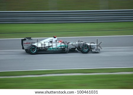 SEPANG, MALAYSIA - MARCH 25 : Panning shot of Mercedes Team driver Michael Schumacher during the race day of F1 Petronas Malaysian Grand Prix at Sepang F1 circuit on March 25, 2012 in Sepang, Malaysia