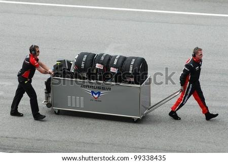 SEPANG, MALAYSIA-MARCH 25 : Pit crews move gear at Petronas F1 Malaysian Grand Prix at Sepang Circuit on March 25, 2012 in Sepang, Malaysia