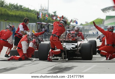 SEPANG, MALAYSIA - NOVEMBER 23 : A1 Team Indonesia changing tyres at pitstop at A1GP World Cup of Motorsport in Sepang, Malaysia November 23, 2008.