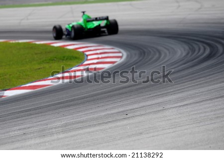 Sepang, Malaysia - November 23: Adam Carroll driver of the Ireland 1A team, taking fast corner, in the Malaysian A1Grand Prix,  Round 3, 2008-2009 Session.