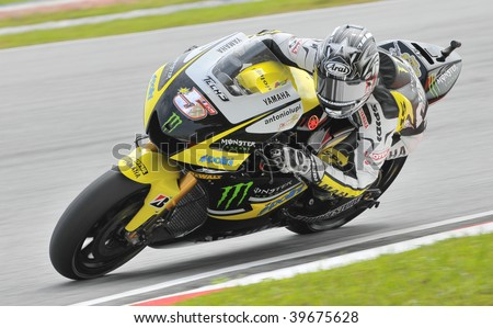 SEPANG, MALAYSIA - OCT 25 : American Colin Edwards of Monster Yamaha Tech 3 negotiates a corner during warm up session at Shell Advance Malaysian Motorcycle Grand Prix on October 25, 2009 in Sepang.