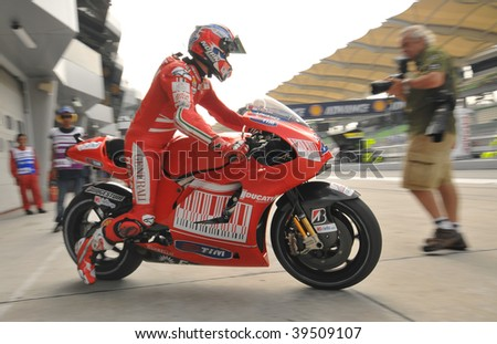 SEPANG, MALAYSIA - OCT 24 : Australian Casey Stoner of Ducati Marlboro Team exits garage during Shell Advance Malaysian Motorcycle Grand Prix on October 24, 2009 in Sepang