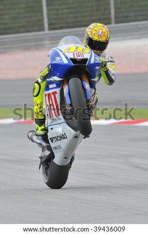 SEPANG, MALAYSIA - OCT 23 : Italian Valentino Rossi of Fiat Yamaha Team does a wheelie after a testing session during Shell Advance Malaysian Motorcycle Grand Prix held October 23, 2009 in Sepang, Malaysia.