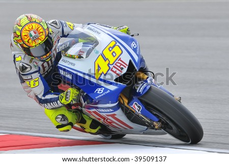 SEPANG, MALAYSIA - OCT 24 : Italian Valentino Rossi of Fiat Yamaha Team takes a corner during qualifying session at Shell Advance Malaysian Motorcycle Grand Prix on October 24, 2009 in Sepang