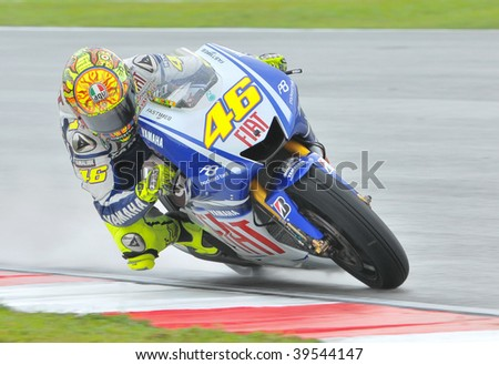 SEPANG, MALAYSIA - OCT 25 : Italian Valentino Rossi of Fiat Yamaha Team takes a corner during race day at Shell Advance Malaysian Motorcycle Grand Prix on October 25, 2009 in Sepang