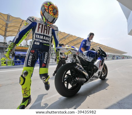 SEPANG, MALAYSIA - OCT 23 : Italian Valentino Rossi of Fiat Yamaha Team walks off his bike after test session during Shell Advance Malaysian Motorcycle Grand Prix held October 23, 2009 in Sepang, Malaysia.