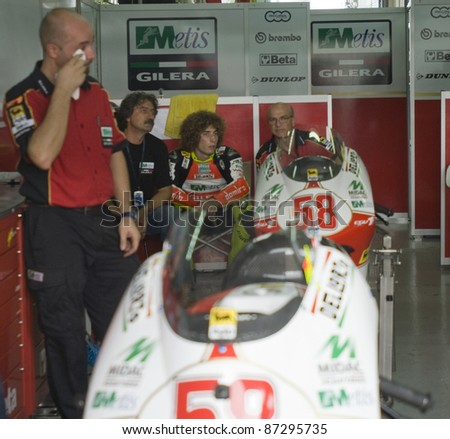 SEPANG, MALAYSIA-OCT. 18:Marco Simoncelli (seated, centre) of Metis Gilera at Polini Malaysian Motorcycle GP on Oct. 18, 2008 in Sepang. Simoncelli died at accident in the Motogp race on Oct. 23, 2011