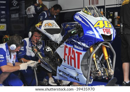 SEPANG, MALAYSIA - OCT 23 : Mechanics prepare Italian Valentino Rossi's bike of Fiat Yamaha Team at Shell Advance Malaysian Motorcycle Grand Prix held October 23, 2009 in Sepang, Malaysia.