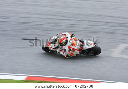 SEPANG, MALAYSIA - OCT 21: MotoGP rider Marco Simoncelli at free practice session on October 21, 2011 at Sepang, Malaysia. Simoncelli died due to accident in the motogp race day on Oct. 23, 2011