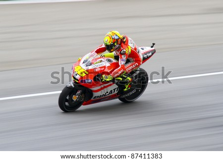 SEPANG, MALAYSIA -OCT 21: Valentino Rossi from Ducati Marlboro Team during during a free practice session on October 21, 2011 in Sepang Malaysia. The Malaysian Grand Prix will take place on Oct 23, 2011.