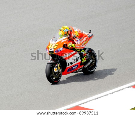 SEPANG, MALAYSIA-OCT 21: Valentino Rossi of Ducati Team in action during practice session of Malaysian Motorcycle Grand Prix on October 21, 2011 in Sepang, Malaysia. - stock photo