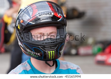 SEPANG, MALAYSIA - OCTOBER 22: Australian Bradley Smith in deep concentration before race at a pre-event Go Kart race at the Shell Malaysian Motorcycle Grand Prix October 22, 2009 in Sepang, Malaysia