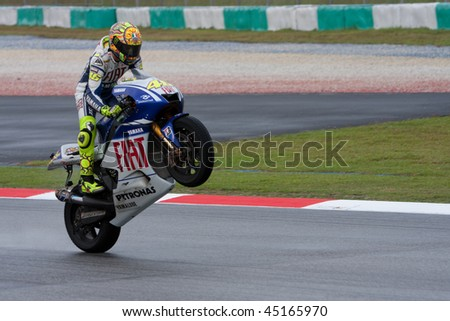 SEPANG, MALAYSIA - OCTOBER 25: Italian Valentino Rossi of Fiat Yamaha Team does a wheelie after winning 09? championship at Shell Malaysian Motorcycle Grand Prix October 25, 2009 in Sepang, Malaysia