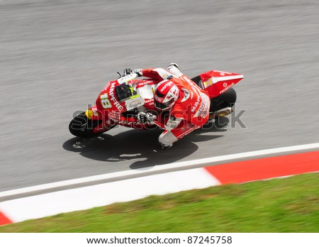 SEPANG, MALAYSIA - OCTOBER 21: Moto2 rider Jordi Torres tests his bike during the free practice session at the Shell Advance Malaysian Motorcycle GP 2011 on October 21, 2011 at Sepang, Malaysia.