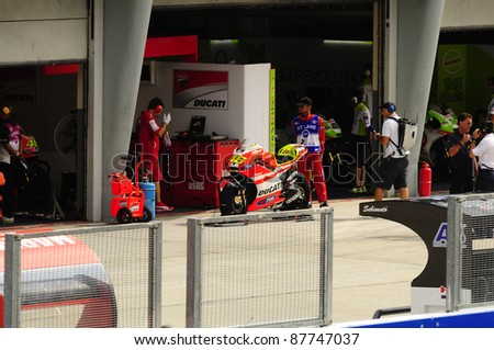 SEPANG, MALAYSIA - OCTOBER 21: MotoGP rider Valentino Rossi returns to the garage after a free practice ride on Day 1 of the Malaysian Motorcycle GP 2011 on October 21, 2011 in Sepang, Malaysia.
