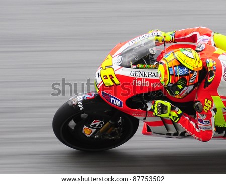 SEPANG, MALAYSIA - OCTOBER 21: MotoGP rider Valentino Rossi tests his bike during the free practice session at the Shell Advance Malaysian Motorcycle GP 2011 on October 21, 2011 in Sepang, Malaysia.