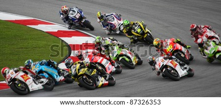 SEPANG, MALAYSIA - OCTOBER 23: MotoGP riders take turn 1 on race day of the Malaysian Motorcycle GP 2011 on October 23, 2011 at Sepang, Malaysia. Marco Simoncelli (58) died in a horrific crash later.