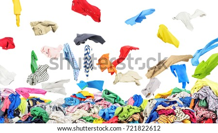 Separate clothing falling at the big pile of clothes on a white background #721822612