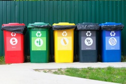 Separate garbage collection. Waste recycling concept. Containers for metal, glass, paper, organics, plastic for further processing of garbage.
