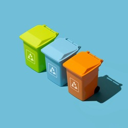 Separate waste collection, disposal and recycling: set of miniature trash cans for waste segregation