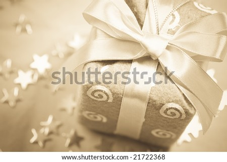 Sepia colors new-year gift background with Christmas decorations