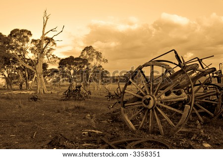 sepia image of an old cart left to rot on the farm
