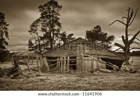 sepia image of an old derelict farm building