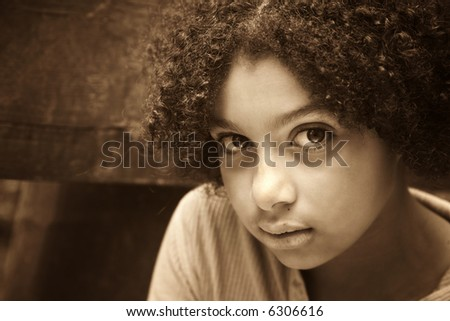 sepia image of child that looks abused and fearful - stock photo