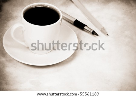 sepia image of cup of coffee and office accessory