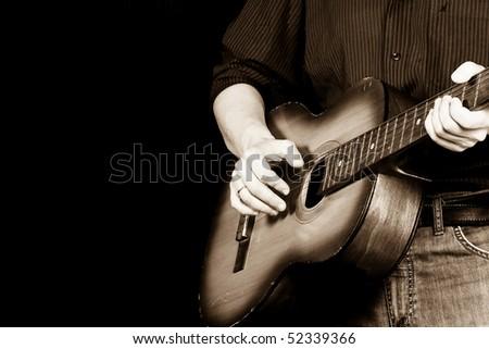 sepia image of guitar and man