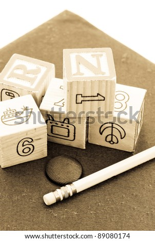 Sepia Image of Toy Blocks and Pencil