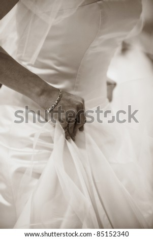 Sepia Picture of a Bride trying on her Gown