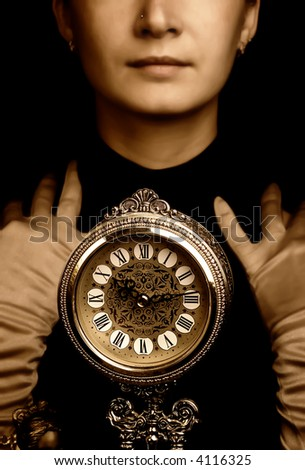 Sepia portrait of a girl with a clock