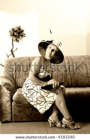 Sepia portrait of an elegant woman on a couch
