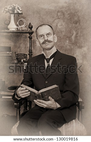 Sepia portrait of man reading the book. Intentional 1900's style expression emulation. - stock photo