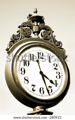Sepia tone image of an antique street clock