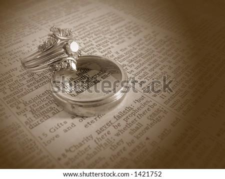 stock photo Sepia tone wedding rings on bible