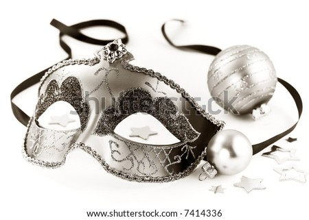 Sepia toned carnival mask and Christmas decorations on white background
